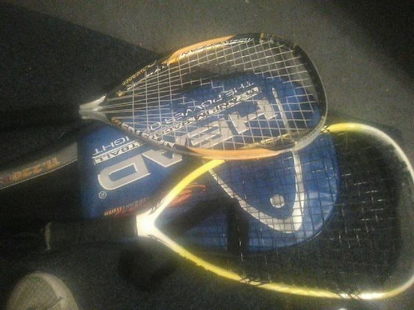 Two tennis rackets with a case