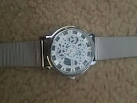 round silver chronograph watch with black strap Montréal, H4N 3A5
