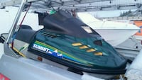 Black and green personal watercraft Abbotsford, V3G 1N7