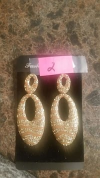 gold-colored clear gemstone encrusted drop earrings with pack