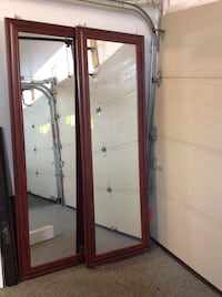 brown wooden framed glass display cabinet Laval, H7N 2T9