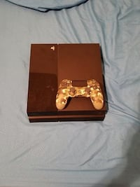 gold-colored Sony PS4 console with controller Peoria
