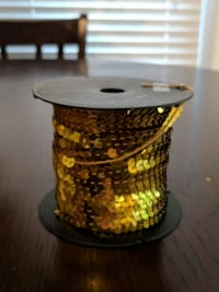 gold-colored sequins reel