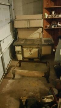Antique cook stove,6 burners with above warmer at top, castiron  Jones