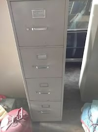 gray metal 4-drawer filing cabinet