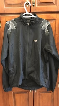Garneau biking jacket. Excellent new condition.  Calgary, T2K 4C5