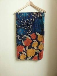 blue, yellow, and orange floral print blanket