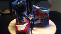 Pair of white-blue-and-yellow super mario-themed basketball shoes New Westminster, V3L 5L7