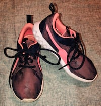 pair of black-and-red running shoes Austin, 78759