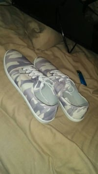 pair of gray-and-white Adidas sneakers 466 km