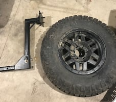 Custom hitch mounted tire carrier