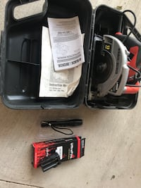 black and red Black&Decker circular saw with box