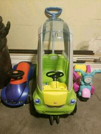 two yellow and green plastic toy cars Burnaby, V5G 4T1