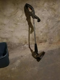black and gray electric string trimmer. Works