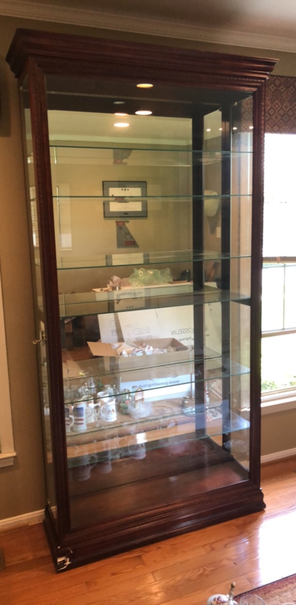 Curio cabinet with  /adjustable  glass shelves