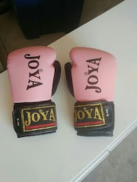pair of pink and black Joya boxing gloves