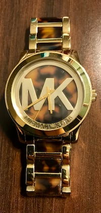 round gold Michael Kors analog watch with gold link bracelet VILLEPLATTE