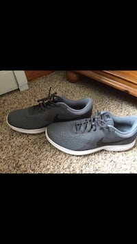 pair of gray Nike running shoes Canal Fulton, 44216