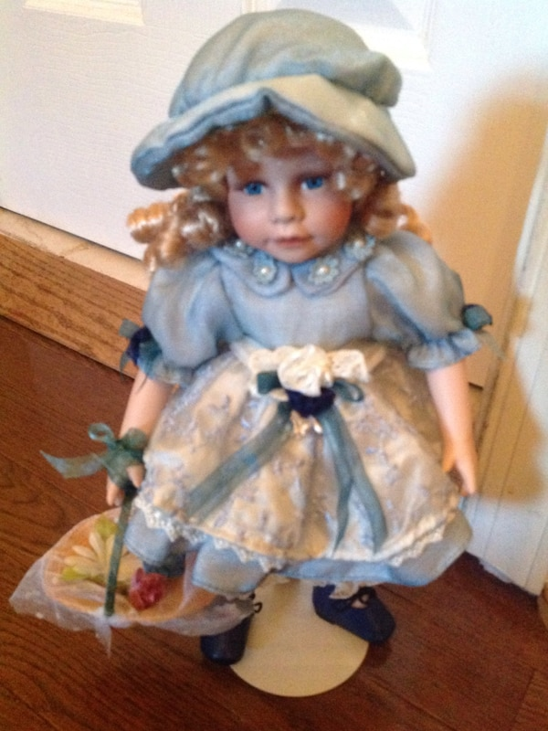Blue and white floral dressed porcelain doll. Adorable collector's item.
