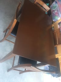 Expandable table with four chairs dining set Calgary, T2X 0J9