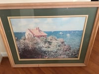 brown wooden framed painting of house beside the sea shore Gainesville, 20155