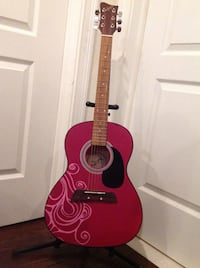 red and black acoustic guitar Howell, 07731
