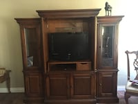 flat screen television with brown wooden TV hutch Ladera Ranch, 92694