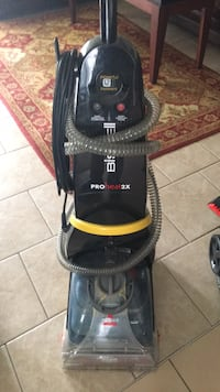 black and red Bissell upright vacuum cleaner Calgary, T2X 1E5