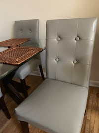 two white leather padded chairs 49 km
