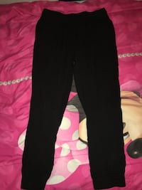 Black very comfortable pants between joggers n dress pants. Size small from Urban Planet Lachine, H8S 3N9
