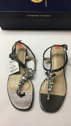 pair of sliver-and-gray Adrienne Vittadini t-strap flat sandals with box