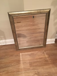 Gold frame wall mirror