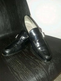 (prada) pair of black leather slip on shoes