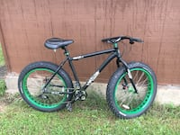 black and green hardtail mountain bike Cogan Station, 17728