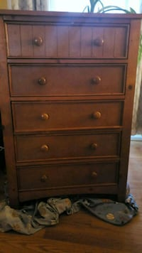 Used brown wooden 5-drawer chest