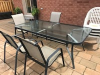 "Patio set 4 chairs and 4 plastic chairs   Table is 84"" X 42"" Vaughan, L4H 1N4"