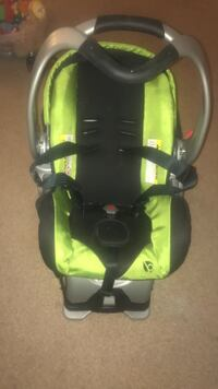 Baby's green and black car seat carrier