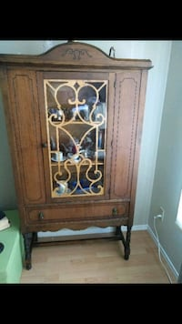 brown wooden framed glass cabinet Sherwood Park, T8H 2S8