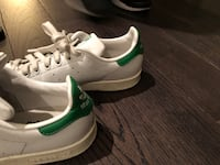 pair of white-and-green Nike sneakers