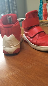Red and white Nike shoes size 9