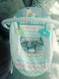 baby's white and green bassinet 47 mi