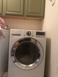 white front-load clothes washer 392 mi