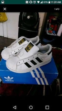 pair of white Adidas Superstar shoes San Diego, 92154