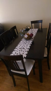 rectangular brown wooden table with six chairs dining set Edmonton, T6L