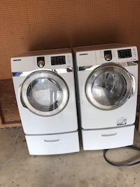 White front load washer and dryer set measures 27x29x52 Potomac, 20854