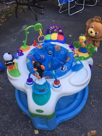 baby's white and blue activity saucer