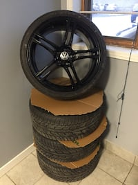black 5-spoke vehicle wheel and tire set 515 km