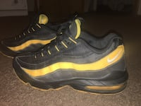 Pair of black-and-yellow nike running shoes Whitehall, 43213