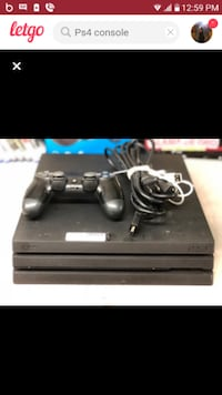black Sony PS4 console with controller Syracuse