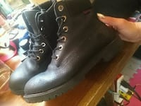pair of black leather combat boots 1966 km